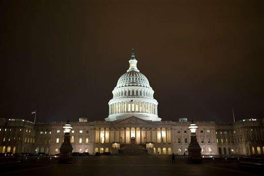 The Capitol is seen at sunrise in Washington, Monday, Jan. 7, 2013. (AP Photo/J. Scott Applewhite) Photo: AP / AP