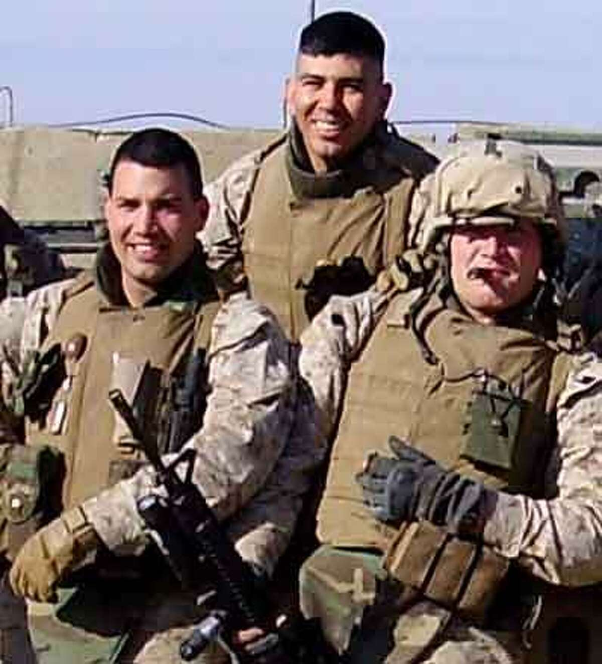 """A 2005 photograph of Sgt. Roman Baca, second from left, with fellow U.S. Marines in Fallujah Irag. Baca was a fire-team leader and machine gunner. Today, veteran Roman Baca carries the title of """"Alumni Associate""""working as a full-time veterans' advocate with the non-profit Mission Continues in New York City. Photo Courtesy of Roman Baca / New Haven Register"""