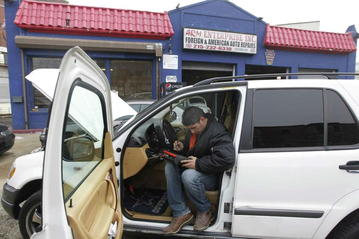 In this Dec. 5, 2011 file photo, Moshe Cohen, the owner of ARM Enterprise: Foreign & American Auto Repair, runs a computer diagnostic check on on a costumers vehicle, in Philadelphia. U.S. service companies, which employ 90 percent of the workforce, expanded at a faster pace in December, helped by solid holiday sales and an economy that picked up strength in the final months of the year.(AP Photo/Matt Rourke, File)
