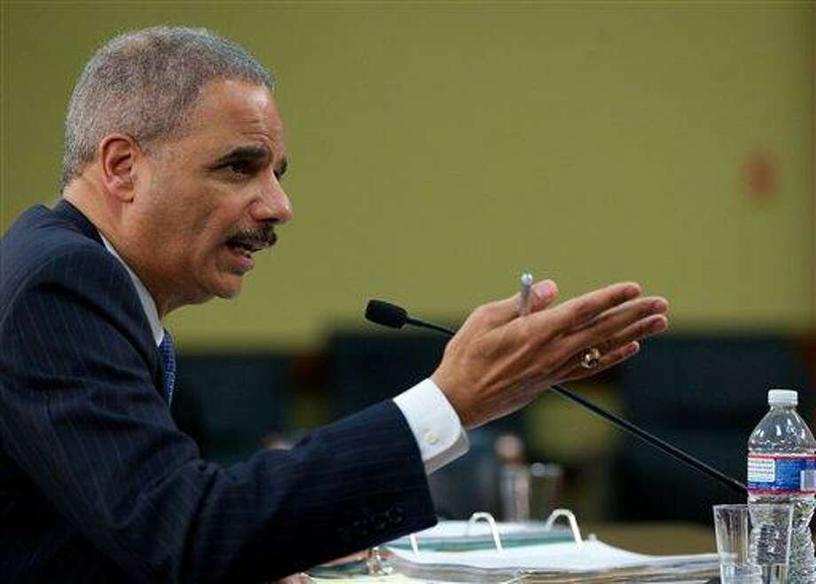 FILE - In this April 18, 2013 file photo, Attorney General Eric Holder testifies on Capitol Hill in Washington. The Justice Department has secretly obtained two months of telephone records of journalists for The Associated Press in what AP's top executive says is an unprecedented intrusion into newsgathering.   (AP Photo/Molly Riley, File) Photo: AP / FR170882 AP