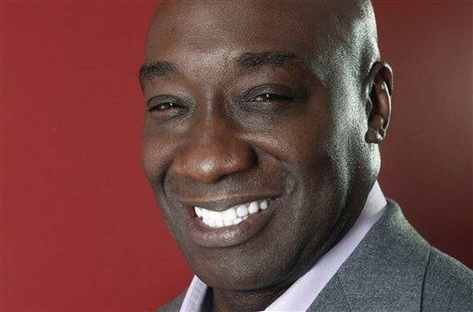 This Wednesday, Jan. 11, 2012 photo shows actor Michael Clarke Duncan in New York. Duncan has died at the age of 54, his fiancee said on Monday, Sept. 3, 2012. (AP Photo/Carlo Allegri) Photo: AP / R-Allegri