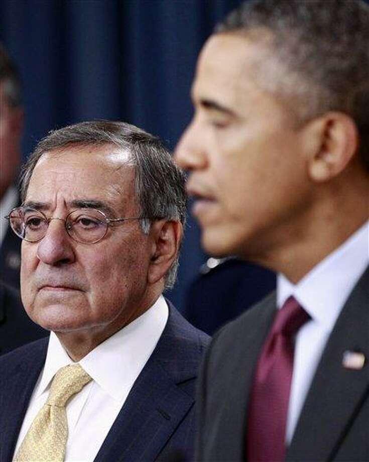 Defense Secretary Leon Panetta listens as President Barack Obama speaks on the Defense Strategic Review Thursday at the Pentagon. Associated Press Photo: AP / AP
