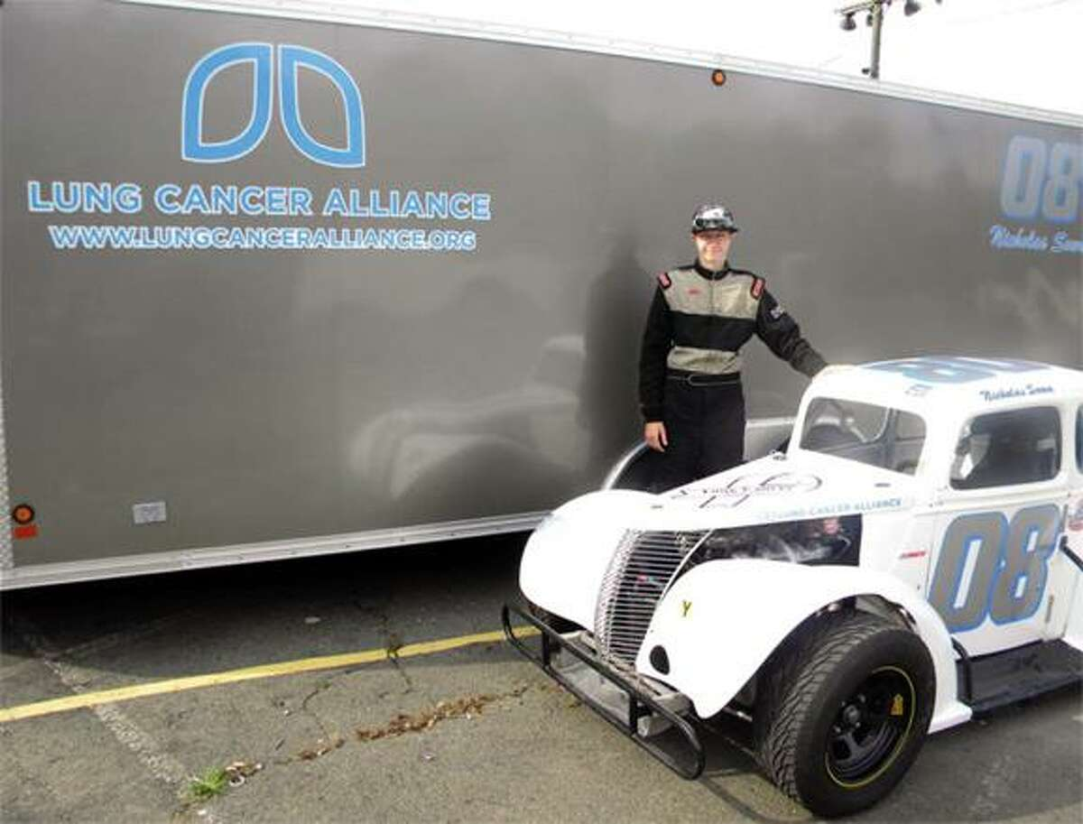 Submitted photo Xavier junior Nicholas Sowa stand with his race car.