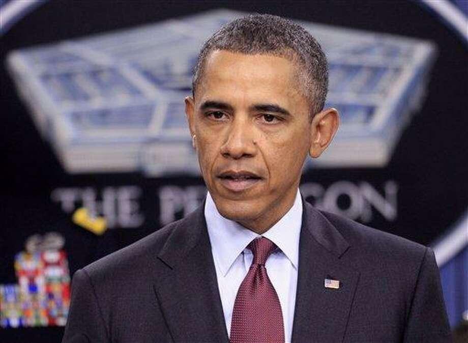 President Barack Obama discusses defense strategic guidance Thursday at the Pentagon. Associated Press Photo: AP / AP