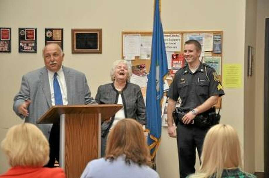 Steve Penn/Special to the Press Cromwell Police Chief Anthony Salvatore, First Selectman Mertie Terry and Sgt. Ryan Parsons at Town Hall during Parsons' promotion on Monday.