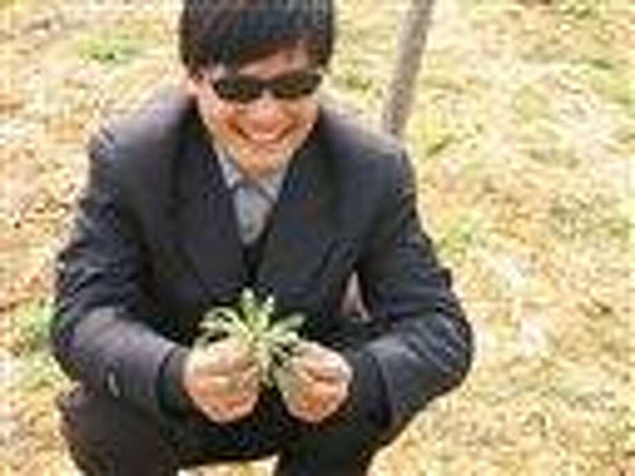This undated photo provided by the China Aid Association shows blind Chinese legal activist Chen Guangchen in Shandong province, China. Chen, a well-known dissident who angered authorities in rural China by exposing forced abortions, made a surprise escape from house arrest April 22 into what activists say was the protection of U.S. diplomats in Beijing, posing a delicate diplomatic crisis for both governments.  Associated Press Photo: AP / Private