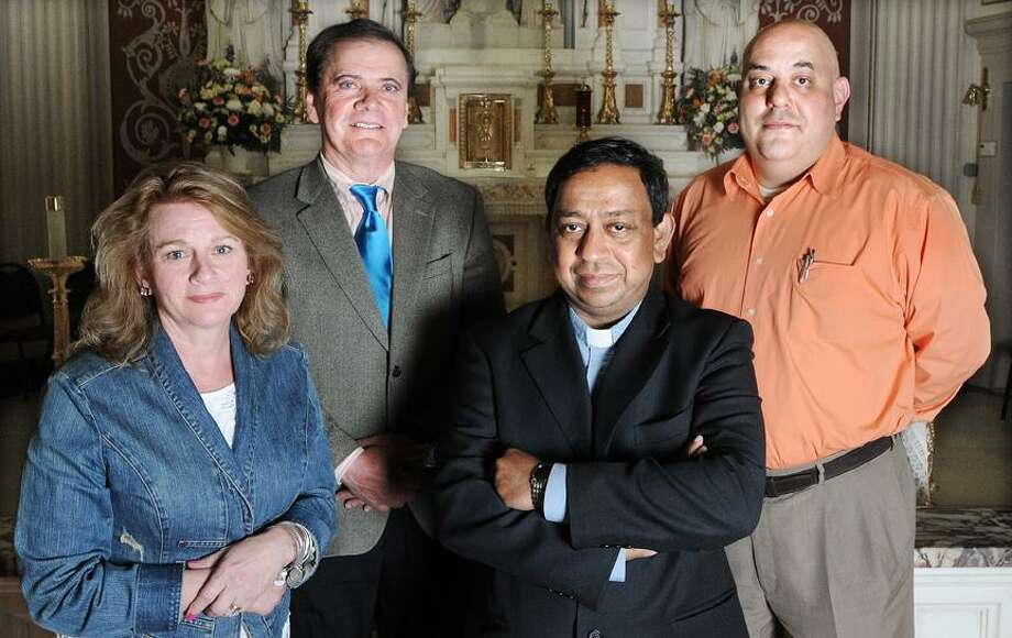 Father James Thaikoottathil, Pastor of St. Sebastian Church in Middletown is pictured with Karen Nocera, festival secretary and festival co-chairmen Gene Nocera, at left and Sal Nesci, at right following a press conference for the St. Sebastian Festival which is held this Friday, Saturday and Sunday. The proceeds of the 92nd festival which is based on the traditions of a 600 year old festival in Melilli, Sicily, Middletown's sister city will benefit the church renovation fund. (Catherine Avalone/The Middletown Press? / TheMiddletownPress