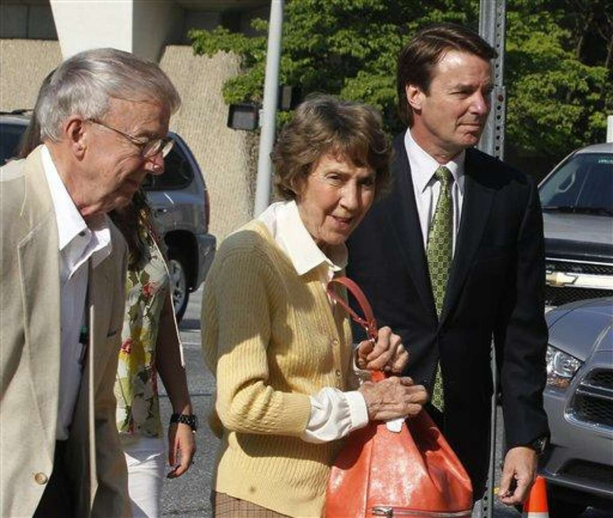 Former Sen. John Edwards, right, leads his mother, Bobbie Edwards, center, and father, Wallace Edwards, into the Federal Courthouse in Greensboro, N.C. Tuesday. Associated Press