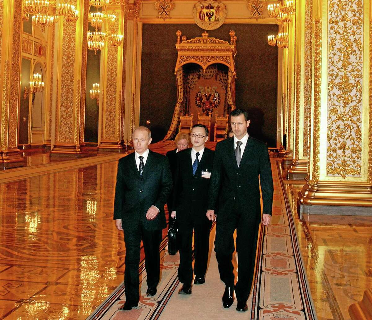 In this Jan. 25, 2005, file photo Syrian President Bashar Assad, right, and Russian President Vladimir Putin, left, walk during their meeting in the Kremlin in Moscow during for a four-day visit amid Israeli allegations that his government sought to buy Russian missiles. Assad and his father before him have been Moscow's foremost Arab allies for decades. Currently much of the weaponry Syria deploys against the rebels fighting to the Assad regime comes from Russia. Even as evidence mounts that his military launched the Aug. 21, 2013, chemical attack that the U.S. says killed more than 1,000 people, Russia insists that the rebels used the deadly chemicals.