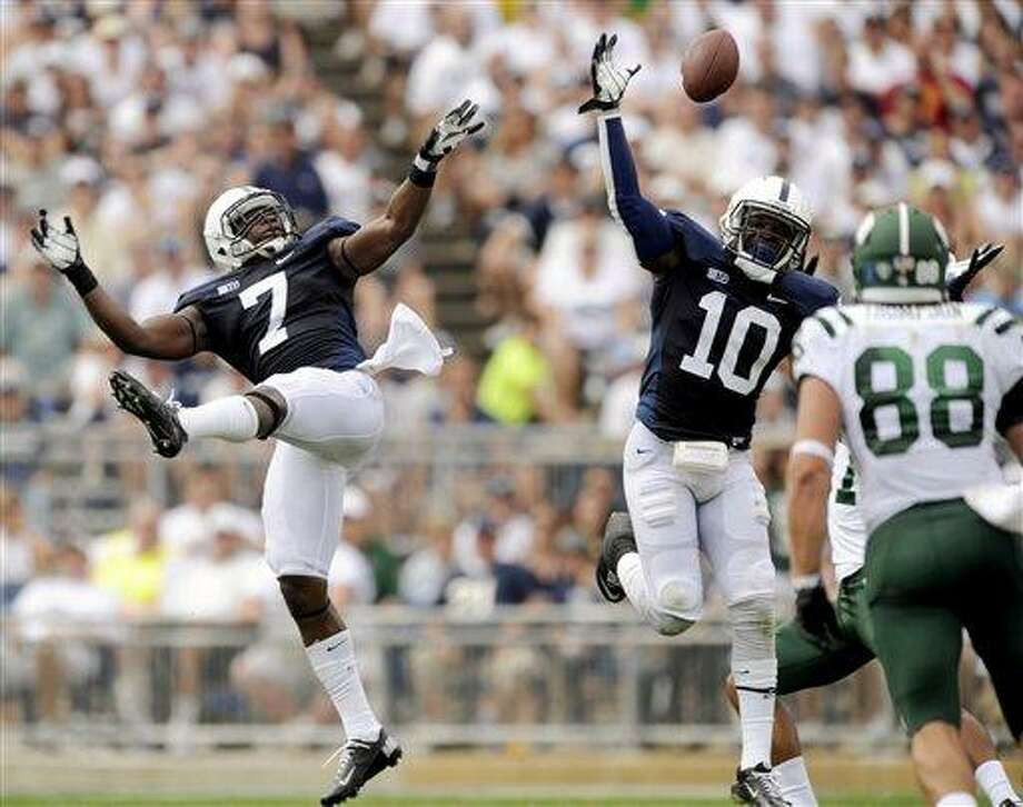Penn State's Stephen Obeng-Agyapong (7) and Malcolm Willis (10) knock a ball up in the air that was then completed to Ohio wide receiver Landon Smith for a touchdown during the second half of an NCAA college football game, Saturday, Sept. 1, 2012, in State College, Pa. Ohio won 24-14. (AP Photo/Centre Daily Times, Nabil K. Mark) MANDATORY CREDIT; MAGS OUT Photo: AP / Centre Daily Times