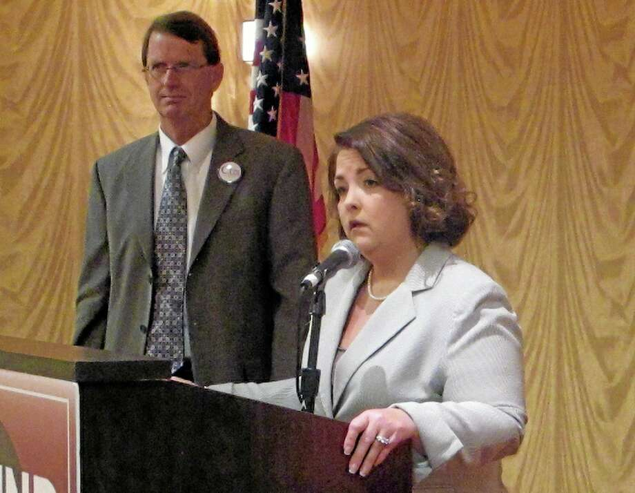 In this Aug. 29, 2013, file photo, Tea Party Express Chairwoman Amy Kremer, speaks in Charleston, S.C.,, businessman Richard Cash listens. Cash is running against Sen. Lindsey Graham, R-S.C., in next year's South Carolina GOP Senate primary. ea party activists helped fuel Republicans' gains in the 2010 elections. But now they're criticizing Republican leaders seemingly at every turn. That puts GOP leaders on Capitol Hill in a tight spot, particularly on how to handle upcoming budget negotiations. Photo: Bruce Smith — The Associated Press  / AP