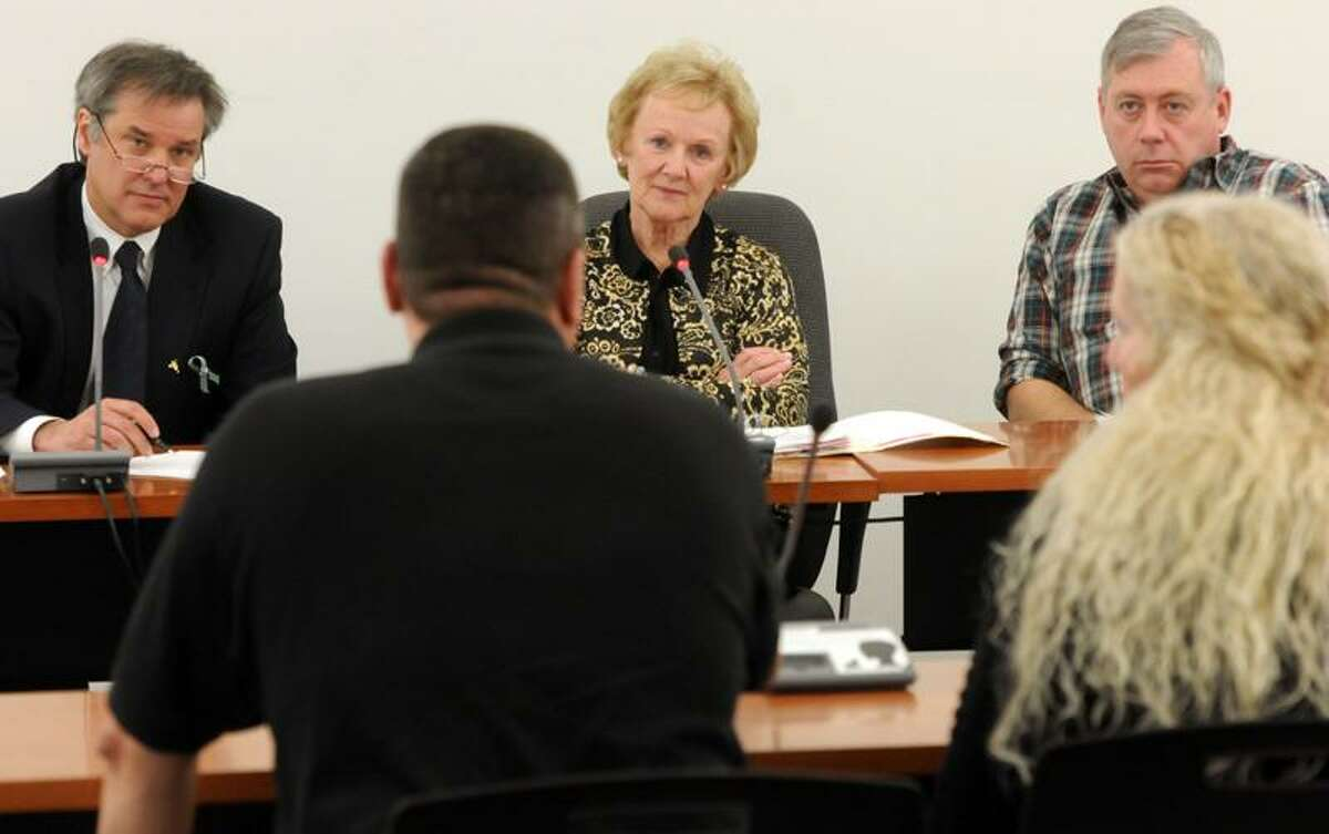 Newtown Municipal Center, selectmen's meeting. Selectmen (facing camera) James Gaston left, William Rodgers, right, and First Selectwoman E. Patricia Llodra, center, listen to Dan LePage of Middletown, vice-president of Punishers LEMC Connecticut Chapter, a motorcycle club. LePage said his club is interested in running a charity ride later in the year for Newtown. LePage's wife Lesa is at right. Mara Lavitt/New Haven Register1/7/13