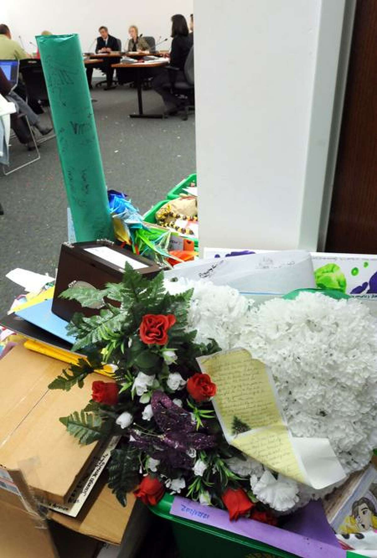 Some of the donations to Newtown from all over the world are housed in the room at the Newtown Municipal Center where the selectmen's meeting is held. Mara Lavitt/New Haven Register1/7/13
