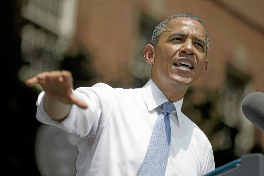 President Barack Obama gestures during a speech on climate change, Tuesday, June 25, 2013, at Georgetown University in Washington. Obama is proposing sweeping steps to limit heat-trapping pollution from coal-fired power plants and to boost renewable energy production on federal property. (AP Photo/Evan Vucci) Photo: AP / AP
