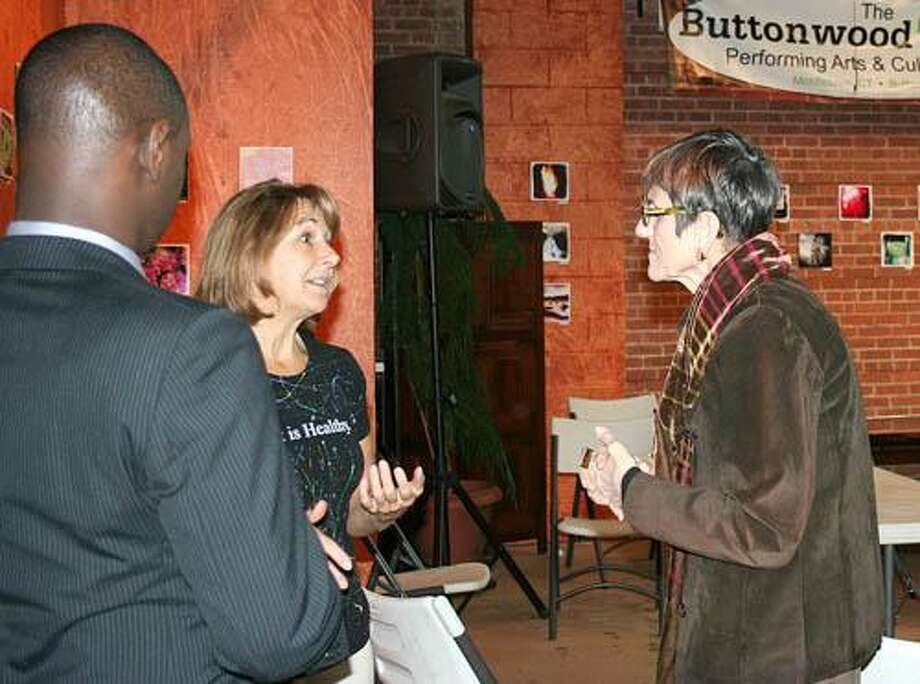 Submitted photo Congresswoman Rosa DeLauro, right, stops by The Buttonwood Tree Performing Arts Center on Main Street in Middletown and talks to Anne-Marie Cannata on Wednesday with Quentin Phipps from the Downtown Business District.