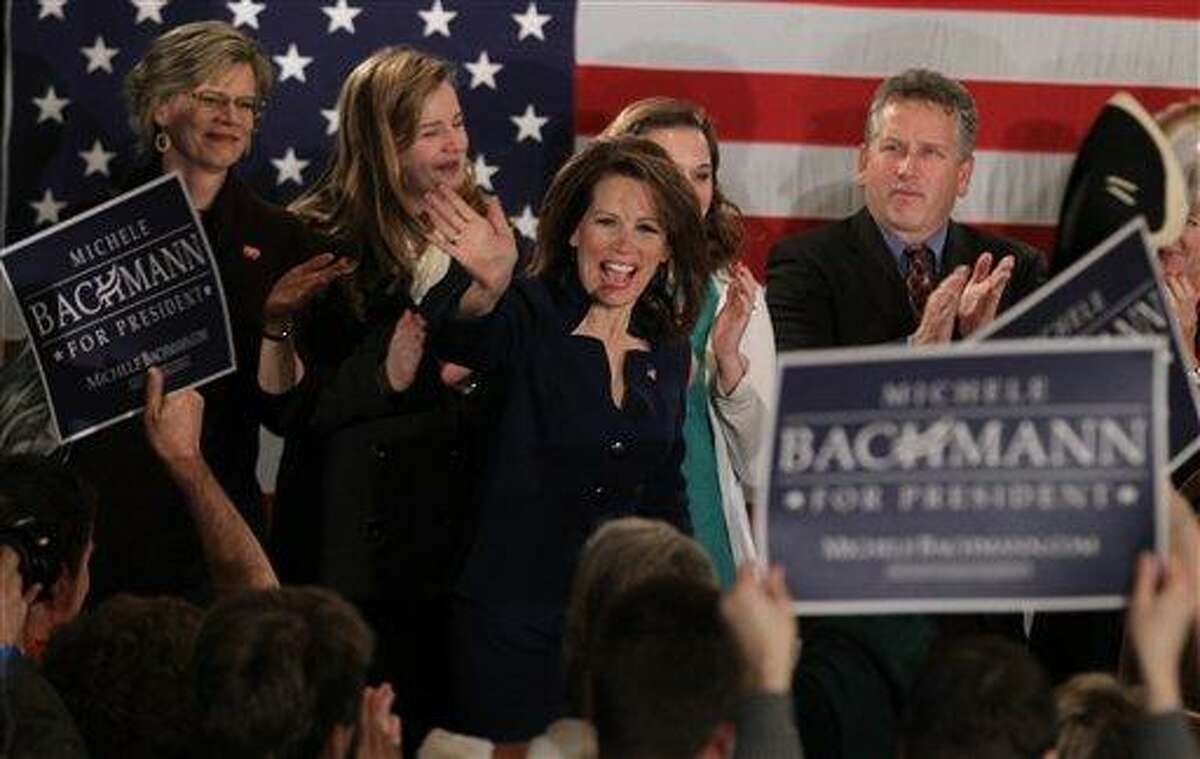 CORRECTS SPELLING OF FIRST NAME - Rep. Michele Bachmann, R-Minn., greets her supporters after speaking at her caucus party at the Marriott in West Des Moines after finishing sixth in the Iowa Caucuses Tuesday night Jan. 3, 2012. (AP Photo/Justin Hayworth,The Des Moines Register)