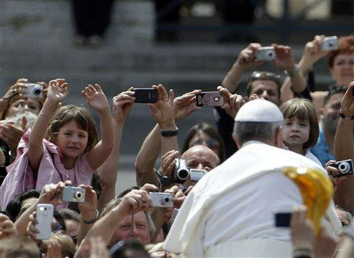 Pope Francis greets the faithful at the end of a canonization mass in St. Peter's Square at the Vatican, Sunday, May 12, 2013. The Pontiff canonized, Antonio Primaldo and his companions, also known as the Martyrs of Otranto, Laura di Santa Caterina da Siena Montoya of Colombia, and Maria Guadalupe Garcia Zavala of Mexico. (AP Photo/Gregorio Borgia)