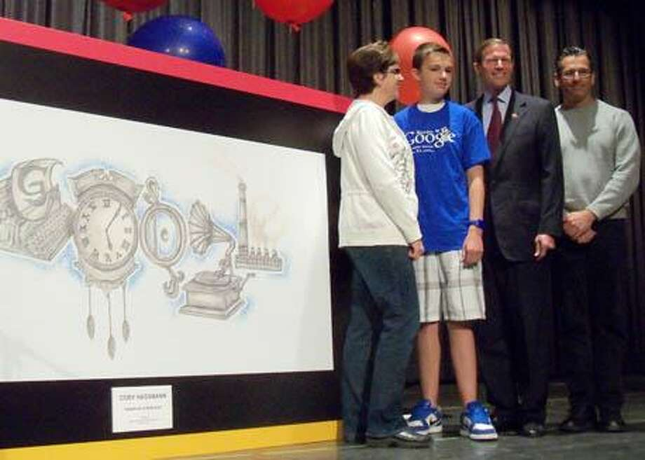 Jonetta Badillo I The Middletown Press Cory Hassman with his parents Leslie and Ross and U.S. Sen. Richard Blumenthal stand next to Cory's design Wednesday at Coginchaug Regional High School.