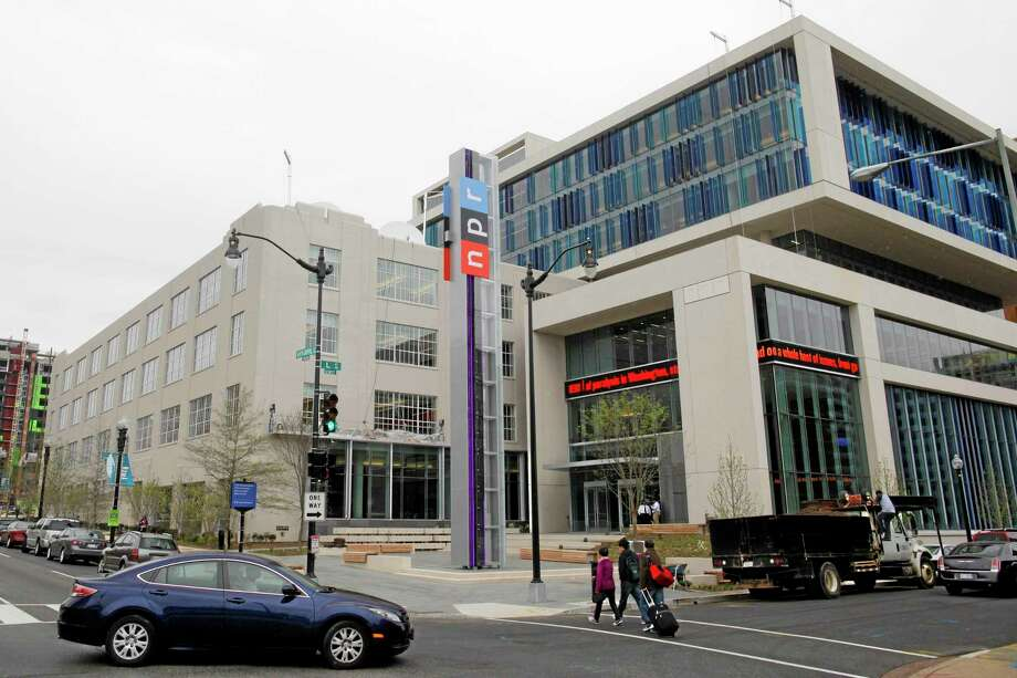 This April 15, 2013 file photo shows the headquarters for National Public Radio (NPR) in Washington. National Public Radio says it's offering across-the-board buyouts in hopes of cutting its staff by 10 percent. The buyouts, which are to be offered across the entire organization, were approved by NPR's board of directors as a way to eliminate a projected operating deficit of $6.1 million. Photo: Charles Dharapak — The Associated Press File Photo  / AP