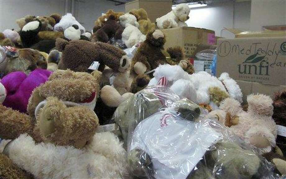 Piles of donated stuffed animals await sorting in a warehouse in Newtown, Conn.  Tens of thousands of items have been sent to the town in the wake of the Dec. 14 massacre at the Sandy Hook Elementary School, forcing officials to set up an infrastructure to deal with the donations. AP Photo/Pat Eaton-Robb Photo: AP / AP