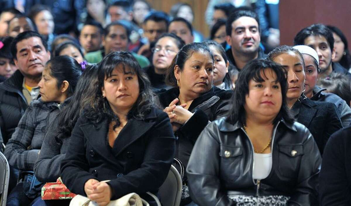The crowd listens as speakers talk at St. Rose's of Lima church supporting a driver's license program for undocumented immigrants in CT. Photo-Peter Casolino