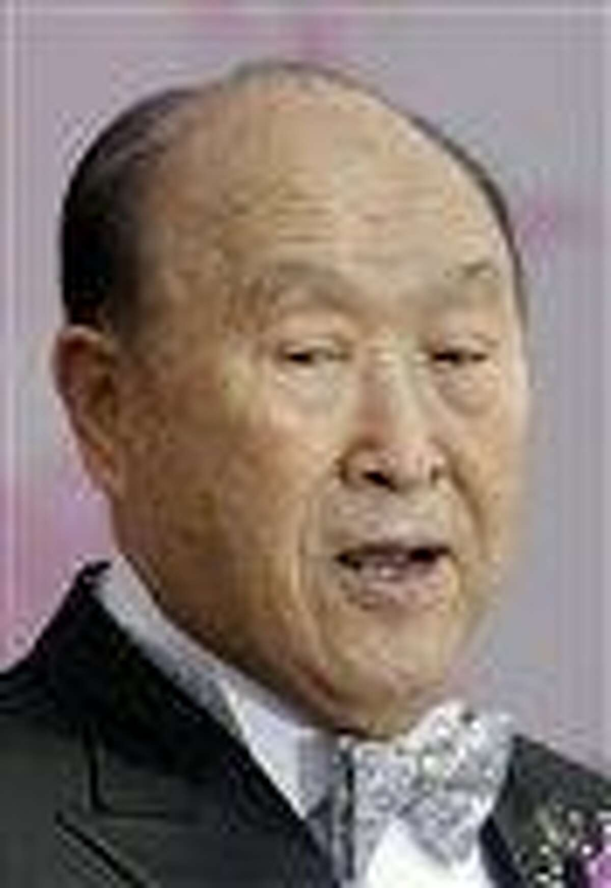 The Rev. Sun Myung Moon speaks during a mass wedding ceremony arranged by the church at Sun Moon University in Asan. AP Photo