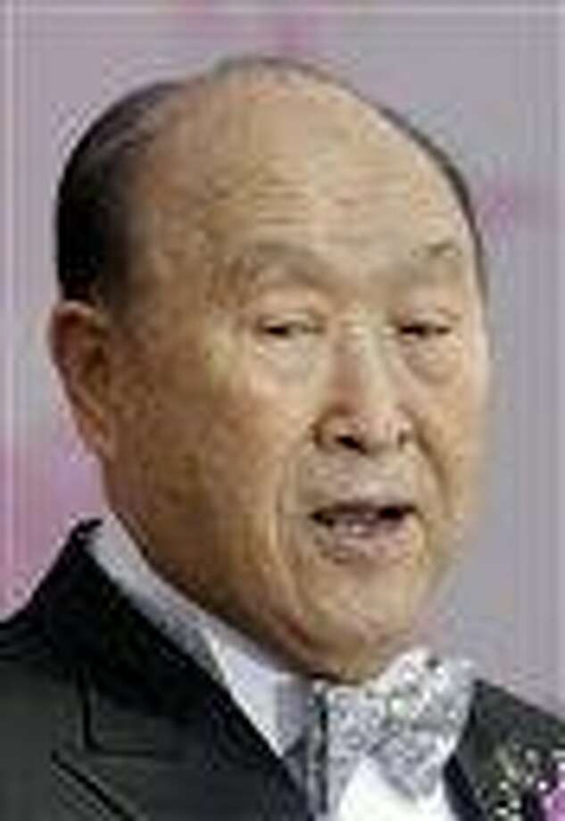 The Rev. Sun Myung Moon speaks during a mass wedding ceremony arranged by the church at Sun Moon University in Asan.  AP Photo Photo: AP / AP