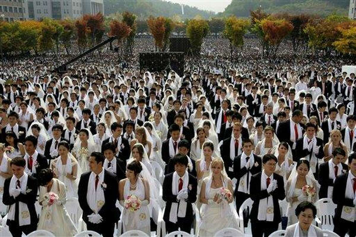 Couples from around the world participate in a mass wedding ceremony arranged by the Rev. Sun Myung Moon's Unification Church at Sun Moon University in Asan. AP Photo