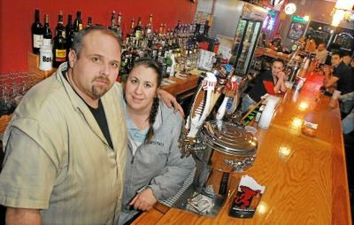 """Matt and Carmela Lockwood, owners of the new bar, Matty's Next Door which is literally next door to Jerry's Pizza, a business owned by the Lockwoods and opened by Carmela's father, Jerry Schiano on December 28, 1968 in Washington Plaza on Washington St. in Middletown. """"Where can you go and eat a chicken parm and pasta at the bar,"""" said Carmela. Jerry's serves pizza until midnight at the bar. Catherine Avalone/The Middletown Press"""