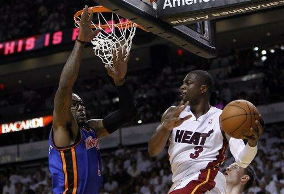 Miami Heat's Dwyane Wade (3) looks to pass as New York Knicks' Amare Stoudemire, left, defends in the first half during an NBA basketball game in the first round of the Eastern Conference playoffs in Miami, Saturday, April 28, 2012. (AP Photo/Lynne Sladky) Photo: AP / AP