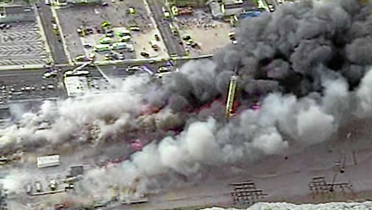 This image from aerial video shows a raging fire in Seaside Park, N.J. on Thursday, Sept. 12, 2013. The fire began in a frozen custard stand on the Seaside Park section of the boardwalk and quickly spread north into neighboring Seaside Heights. (AP Photo/ABC)
