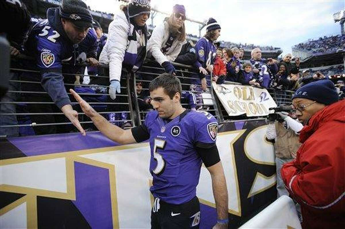 Baltimore Ravens quarterback Joe Flacco (5) walks of the field and greets fans after the second half of an NFL wild card playoff football game against the Indianapolis Colts, Sunday, Jan. 6, 2013, in Baltimore. The Ravens won 24-9. (AP Photo/Nick Wass)