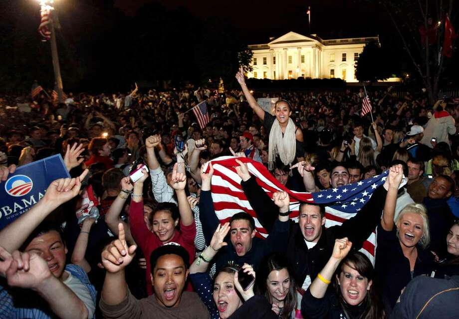 Crowds gathers outside the White House in Washington early Monday, May 2, 2011, to celebrate after President Barack Obama announced the death of Osama bin Laden. Associated Press file photo Photo: ASSOCIATED PRESS / AP2011