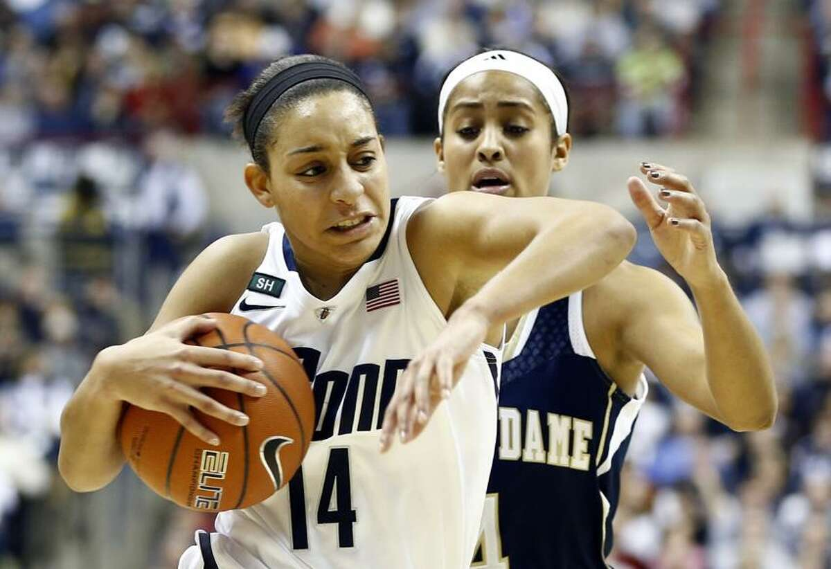 Jan 5, 2013; Storrs, CT, USA; Connecticut Huskies guard Bria Hartley (14) drives to the hoop against Notre Dame Fighting Irish guard Skylar Diggins (4) during the first half at Gampel Pavilion. Mandatory Credit: Mark L. Baer-USA TODAY Sports