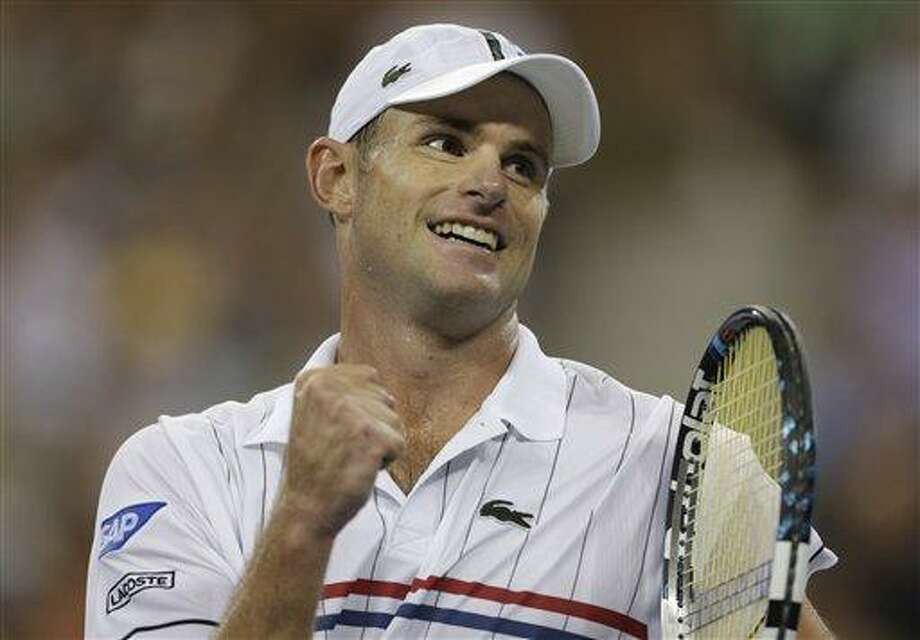 Andy Roddick reacts after beating Australia's Bernard Tomic in the third round of play at the 2012 US Open tennis tournament,  Friday, Aug. 31, 2012, in New York. (AP Photo/Charles Krupa) Photo: AP / AP