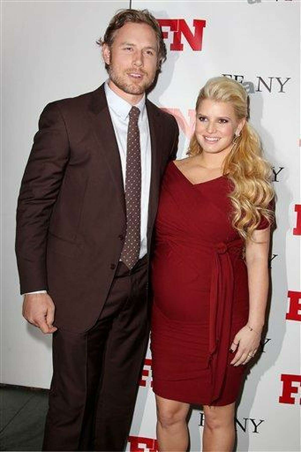 In this Nov. 29, 2011 file photo, singer Jessica Simpson, right, poses with her fiance Eric Johnson at the 25th Annual Footwear News Achievement Awards at The Museum of Modern Art in New York. A publicist for the singer confirmed Simpson gave birth to a daughter named Maxwell Drew Johnson in Los Angeles on Tuesday, May 1. Maxwell weighed 9 lbs. 13 ounces, said publicist Lauren Auslander. It's the first child for 31-year-old Simpson and her 32-year-old fiance Eric Johnson, a former NFL player. Associated Press