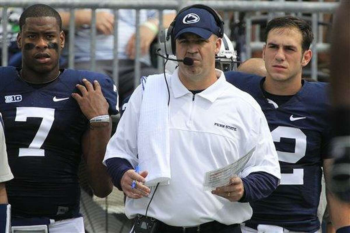 Penn State head coach Bill O'Brien, center, stands in front of Penn State quarterbacks Paul Jones (7) Steven Bench, right, on the sidelines during the first quarter of an NCAA college football game against Ohio at Beaver Stadium in State College, Pa., Saturday, Sept. 1, 2012. (AP Photo/Gene J. Puskar)