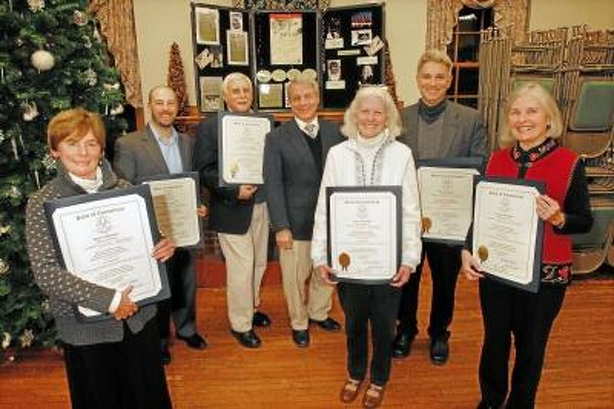 Catherine Avalone/The Middletown Press Senator Len Suzio presented citations from the Conn. General Assembly to members of the Greater Middletown Chorale's Letter for their involvement in Italy, 1944 - A soldier's story told in Music Sarah Meneely-Kyder, Artistic Director, Joseph D'Eugenio, Phil Cacciola, Advisory Board member, Nancy Meneely, Poet/Lyricist, Rich Pugliese, committee chairnan, and Joyce Kirkpatrick, Chair of the Development GMC Friday afternoon at First Church of Christ. The dramatic oratorio will be presented Sunday, April 28 at 4 p.m. at Middletown High School Center for the Performing Arts.