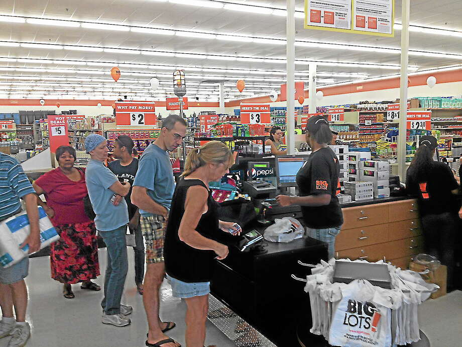 New customers checkout items purchased during the grand opening of the Big Lots! store in Middletown on Friday. Photo: Mike T. Lyle — The Middletown Press