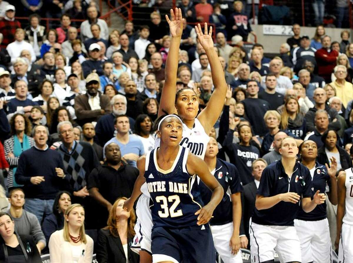 Connecticut's Kaleena Mosqueda-Lewis watches with Notre Dame's Jewell Loyd (32) her three-point shot attempt with six seconds left in an NCAA college basketball game against Notre Dame in Storrs, Conn., Saturday, Jan. 5, 2013. Notre Dame got the rebound on Mosqueda-Lewis's missed shot and won 73-72. (AP Photo/Jessica Hill)