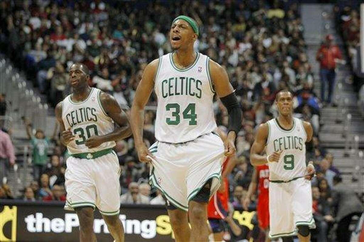 Boston Celtics small forward Paul Pierce (34) celebrates a basket in second-half action of an NBA basketball game against the Atlanta Hawks, Saturday, Jan. 5, 2013, in Atlanta. The Celtics won 89-81. (AP Photo/Todd Kirkland)