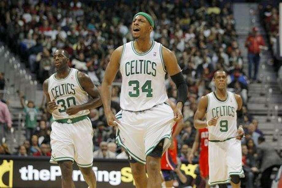 Boston Celtics small forward Paul Pierce (34) celebrates a basket in second-half action of an NBA basketball game against the Atlanta Hawks, Saturday, Jan. 5, 2013, in Atlanta. The Celtics won 89-81. (AP Photo/Todd Kirkland) Photo: ASSOCIATED PRESS / Todd Kirkland2012