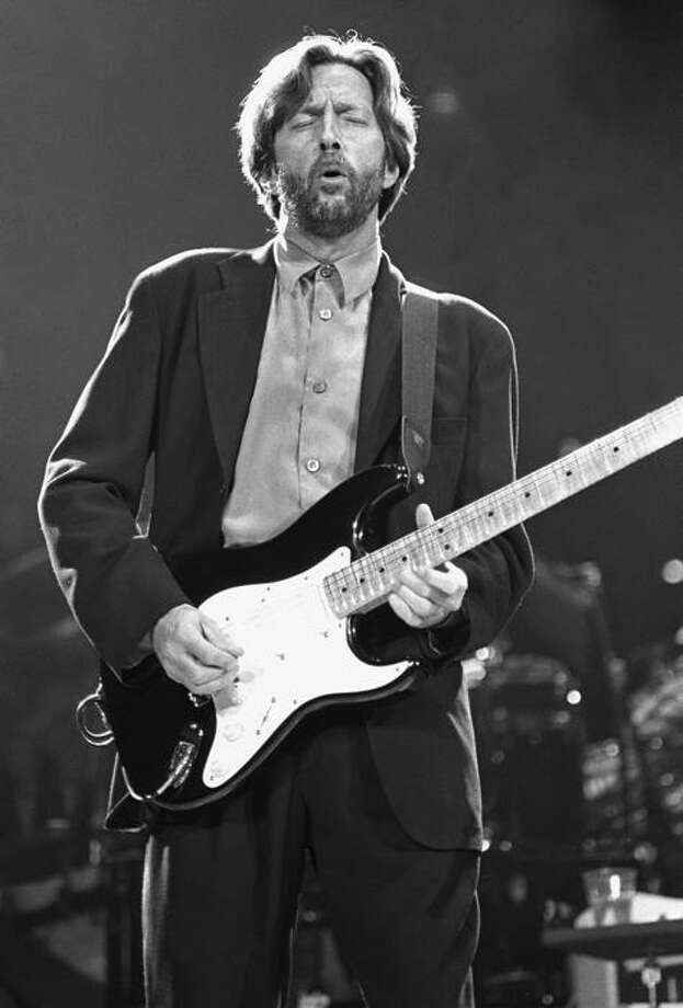 "Musician Eric Clapton is shown performing on stage during a ""live"" concert appearance. Photo: John Atashian / John Atashian"