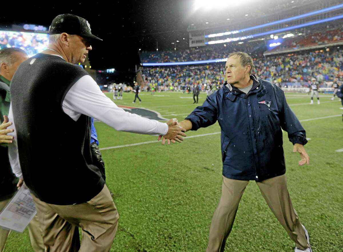 Jets head coach Rex Ryan, left, and Patriots head coach Bill Belichick shake hands after Thursday's game in Foxborough, Mass. The Patriots won 13-10.