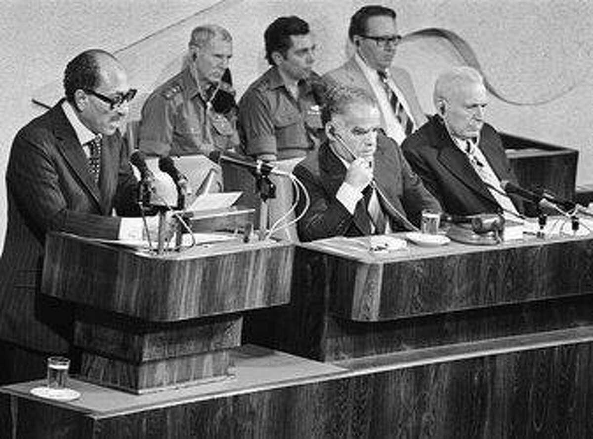 Former Israeli Prime Minister Yitzhak Shamir, front center, listens during a 1977 visit by Egypt's Anwar al-Sadat. New York Times photo