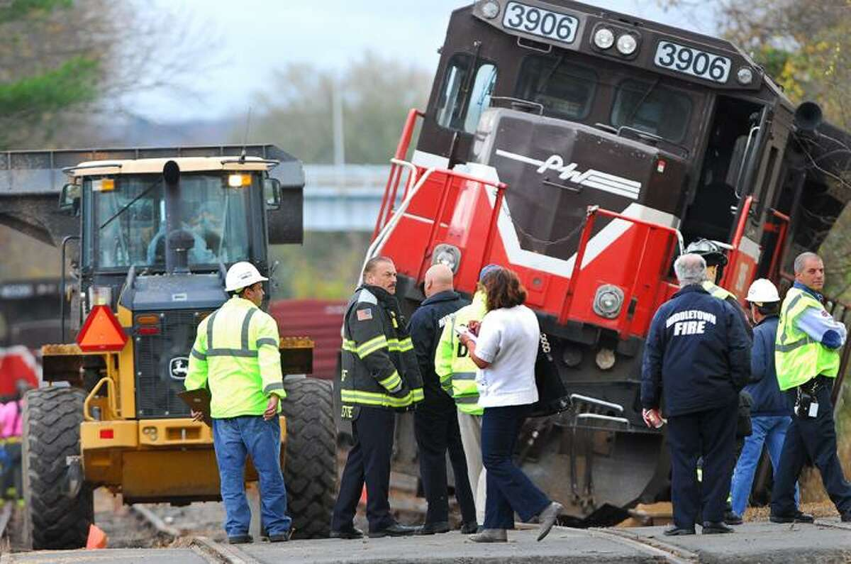 Catherine Avalone/The Middletown PressEmergency personnel in Middletown respond to a single train engine carrying 2,000 gallons of fuel derailed off the track at the railroad crossing near the transfer station in Middletown.