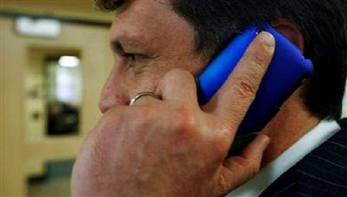 FILE - In this March 2, 2010 file photo, an unidentified man talks on his cell phone in Augusta, Maine. When a mysterious, unauthorized fee appears on your cellphone bill, it's called