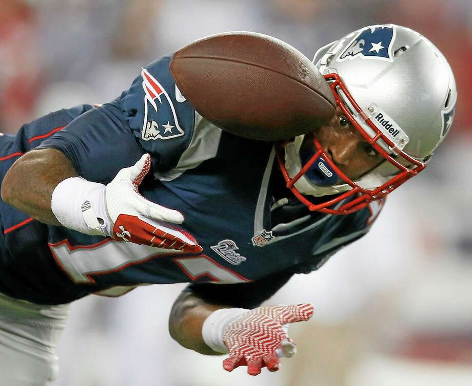 Patriots wide receiver Aaron Dobson can't make the reception on a pass from Tom Brady during the second quarter of Thursday's game against the New York Jets in Foxborough, Mass. Photo: Elise Amendola — The Associated Press  / AP
