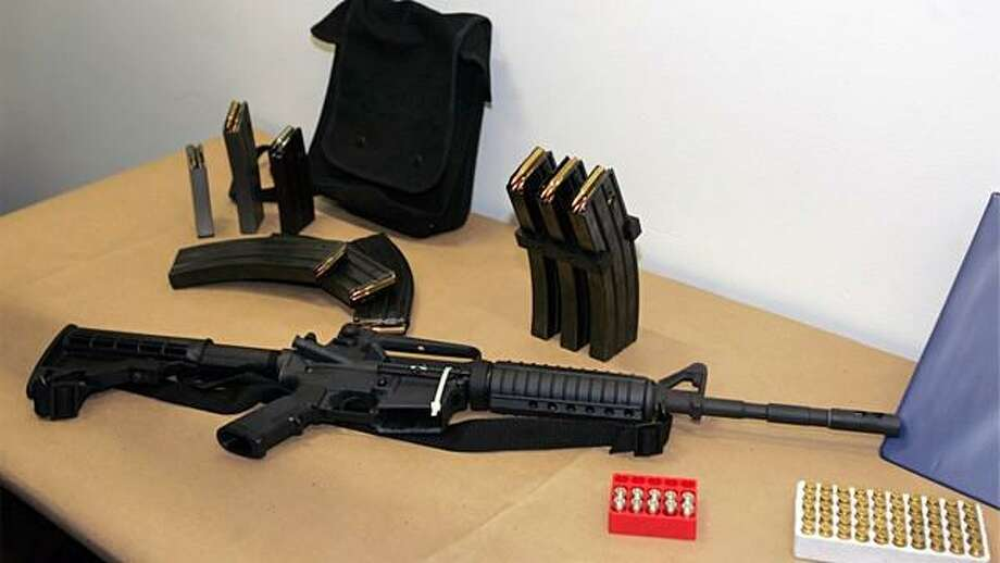 A Vermont teacher surrendered a Bushmaster semi-automatic assault rifle to police Monday, similar to the one shown above. Associated Press file photo