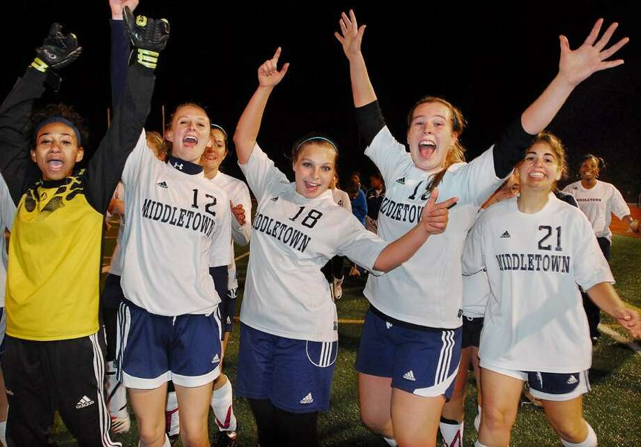 Catherine Avalone/The Middletown Press Middletown High seniors Aaliyah Ahmad (GK), Cara Brainard (12), Amanda Lubee (18), Erin Gardell (19) and Denese Samuels (21) celebrate following their 3-0 win against Bulkeley, which capped the first undefeated regular season in program history.